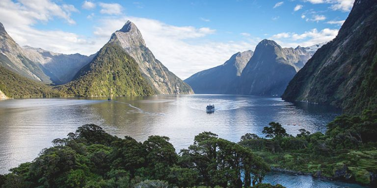 Milford sound peaks with cruise ship approaching