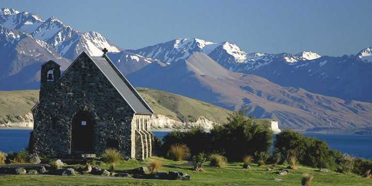 Church of the Good Shepherd with Lake Tekapo and mountains in the background