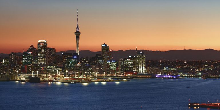Auckland city skyline and harbour at sunset